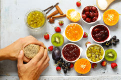 Assorted berries and fruit jams. Homemade canning. Fresh berries and fruits Stock Photos