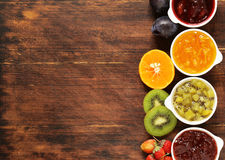Assorted berries and fruit jams. Homemade canning. Fresh berries and fruits Royalty Free Stock Images