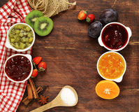 Assorted berries and fruit jams. Homemade canning. Fresh berries and fruits Royalty Free Stock Photography