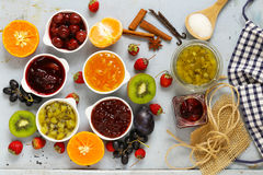 Assorted berries and fruit jams. Homemade canning. Fresh berries and fruits Royalty Free Stock Photo