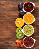 Assorted berries and fruit jams. Homemade canning. Fresh berries and fruits Stock Image