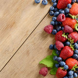 Assorted berries on the table Royalty Free Stock Photo
