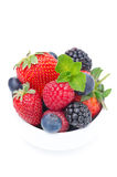 Assorted berries in a white bowl, isolated, top view Royalty Free Stock Photography