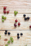 Assorted berries on wooden table Stock Images