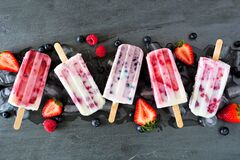 Free Assorted Berry Fruit Yogurt Popsicles, Top View In A Row Over Slate Stock Photos - 183773863