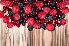 Assorted Berry on the wooden table Stock Photography