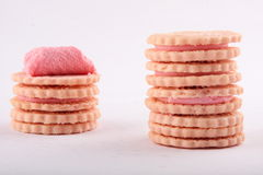Assorted biscuit sandwiches with strawberry cream Stock Image