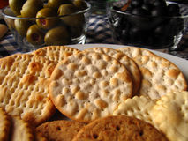 Assorted biscuits and olives. Different types of traditional mediterranean olives and assorted biscuits Stock Photos