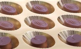 Assorted black chocolate in a box Royalty Free Stock Photo
