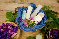 Assorted body lotions. Assorted natural cosmetics in a basket Royalty Free Stock Images
