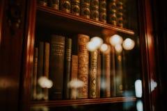 Assorted Books in Bookshelf Stock Photos