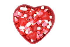 Assorted bowl valentines candy. On white background royalty free stock photos