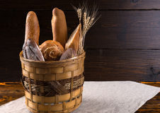 Assorted bread and baguettes in a rustic basket Royalty Free Stock Photo