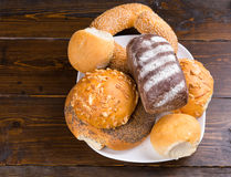 Assorted bread rolls and a bagel on a plate Royalty Free Stock Photography