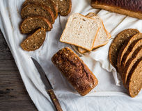 Assorted bread, slices of rye bread on linen tablecloths, wooden Stock Images