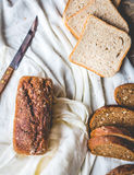 Assorted bread, slices of rye bread on linen tablecloths, wooden Stock Photo