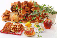 Assorted breads with tea Royalty Free Stock Photo