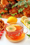 Assorted breads with tea Stock Image
