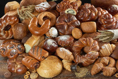 Assorted breads on white stock photos