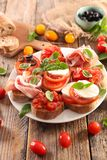 Bruschetta. Assorted bruschetta with tomato, mozzarella, olive Stock Photography