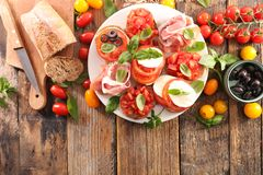 Bruschetta. Assorted bruschetta with tomato, mozzarella, olive Stock Photos