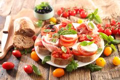 Bruschetta. Assorted bruschetta with tomato, mozzarella, olive Stock Photo