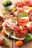 Bruschetta. Assorted bruschetta with tomato, mozzarella, olive Stock Image