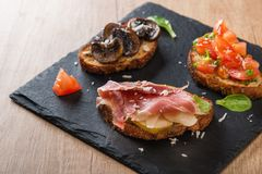 Assorted bruschettas Royalty Free Stock Images