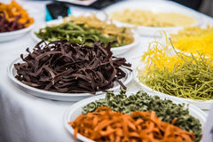 Assorted bundles of colorful raw pasta noodles Stock Image