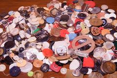 Assorted buttons. Different in color, mostly plastic, some wooden. Pile of buttons close up background. NRetro image royalty free stock image