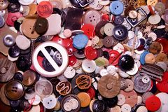 Assorted buttons. Different in color, mostly plastic, some wooden. Pile of buttons close up background. Retro image royalty free stock photography