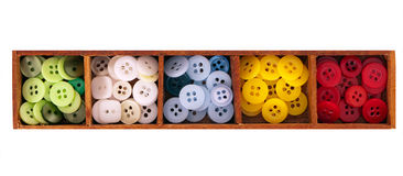 Assorted buttons in wooden box, isolated Stock Image