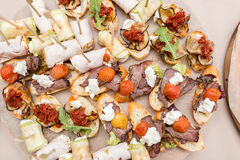Assorted canape with cheese, meat, rolls, bakery and vegetables. selective focus Royalty Free Stock Photo