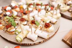 Assorted canape with cheese, meat, rolls, bakery and vegetables. selective focus Stock Image