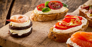 Assorted canapes on bread and blinis Royalty Free Stock Photos
