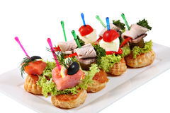 Assorted canapes-sandwiches on plate over white background Royalty Free Stock Photography
