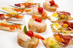 Assorted canapes on tray royalty free stock images