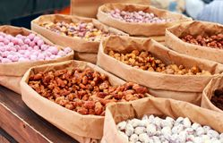 Assorted candied nuts and snacks. Selective focus royalty free stock photos