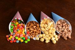 Assorted candies in paper cones royalty free stock photography
