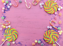 Assorted Candy And Lollipop On Pink Wood Table. Royalty Free Stock Images