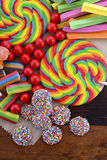Assorted candy with brown paper bag. Royalty Free Stock Images