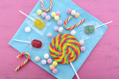 Assorted candy and lollipop on pink wood table. Stock Image