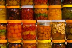 Assorted canned fruits. A lot of jars with assorted canned fruits Stock Images