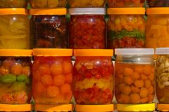 Assorted canned fruits. A lot of jars with assorted canned fruits Royalty Free Stock Photography