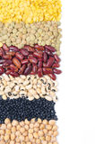 Assorted cereals and legumes with space for text isolated Royalty Free Stock Images