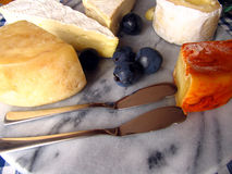 Assorted cheese. Different types of traditional mediterranean cheese on a stone plate Stock Photos