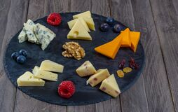 assorted cheese board with honey and nuts