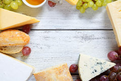 Assorted cheese on the boards Stock Images