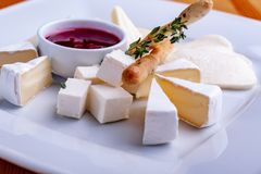 Assorted cheese with cranberry sauce, selective focus stock photos