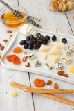 Assorted with cheese , fruits and nuts  on the white wooden table Royalty Free Stock Image